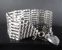 Wide link silver bracelet with padlock