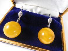 Yolk amber ball hinged earrings