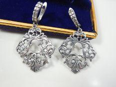 Silver rhomboid shaped earrings