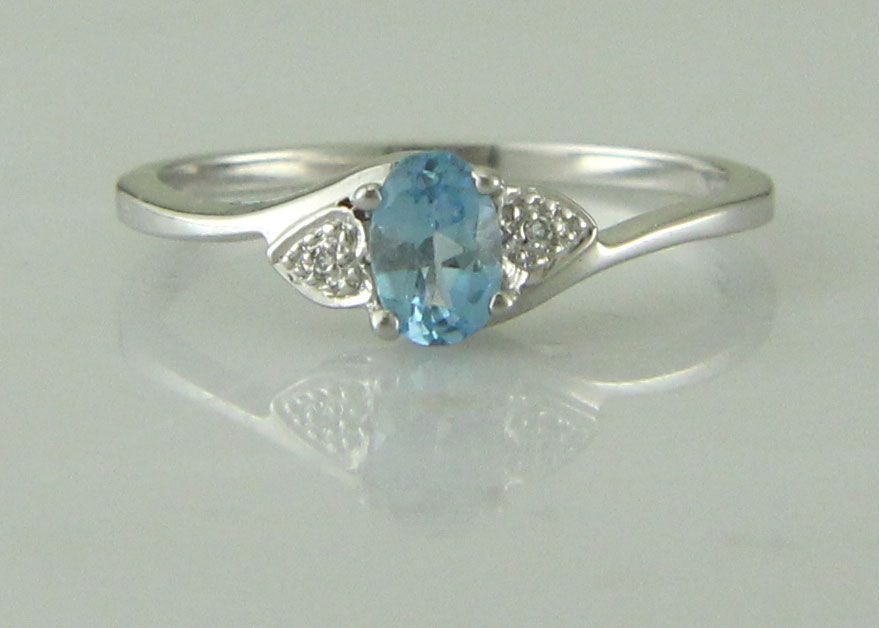 Lot 51 - 9ct White Gold Fancy Cluster Diamond Blue Topaz Ring 0.01 Carats