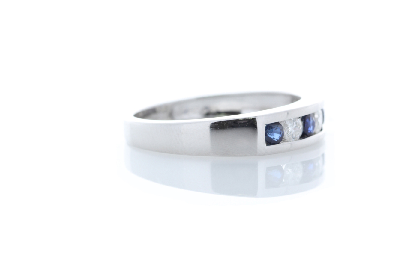 Lot 50 - 9ct White Gold Channel Set Semi Eternity Diamond And Sapphire Ring 0.25 Carats