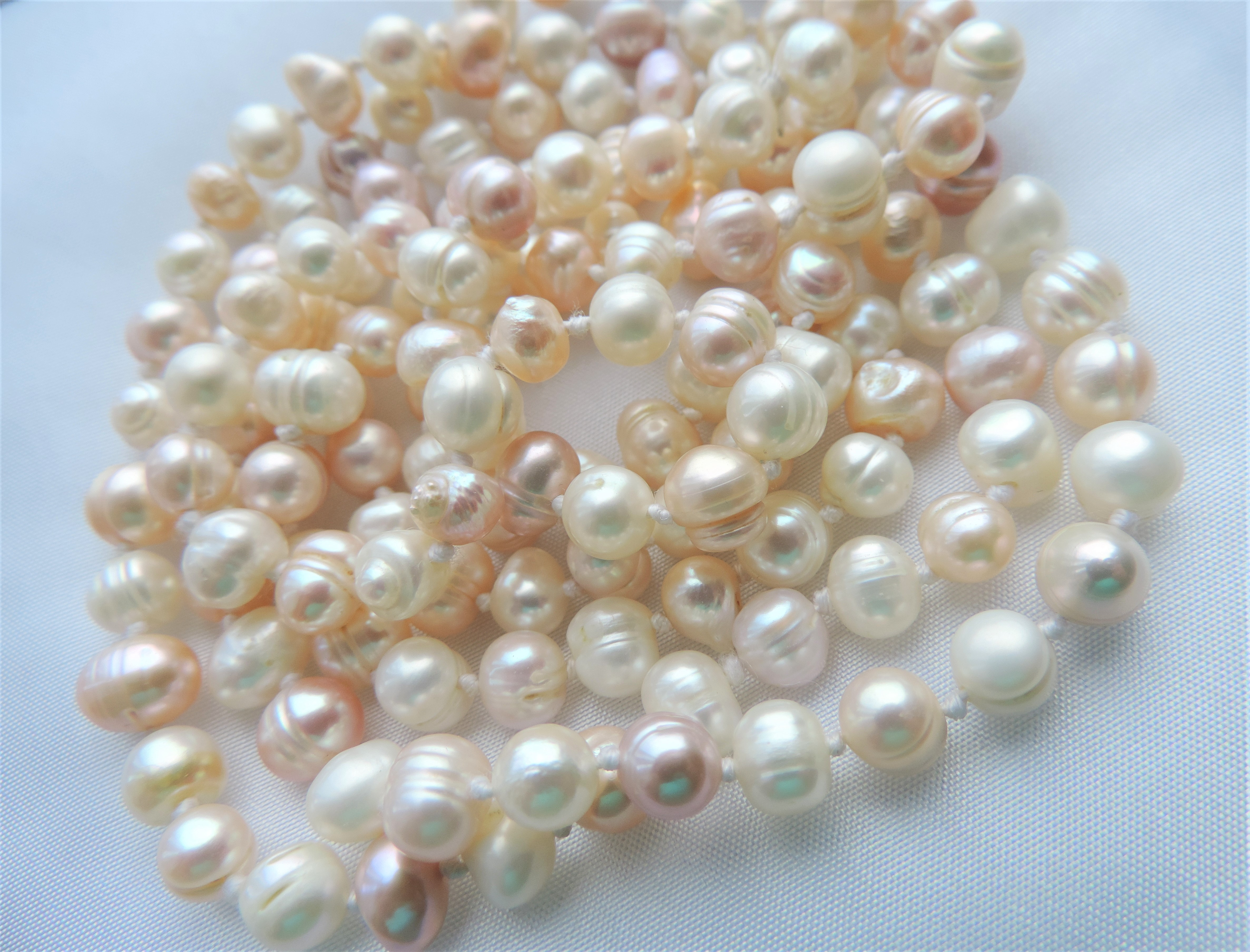 Lot 164 - Cream, Pink & Peach Cultured Pearl Necklace 45 inches