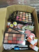 Circa. 200 items of various new make up acadamy make up to include: glow beam highlighting powd...