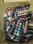 Circa. 200 items of various new make up acadamy make up to include: blush perfection, eyeshadow...