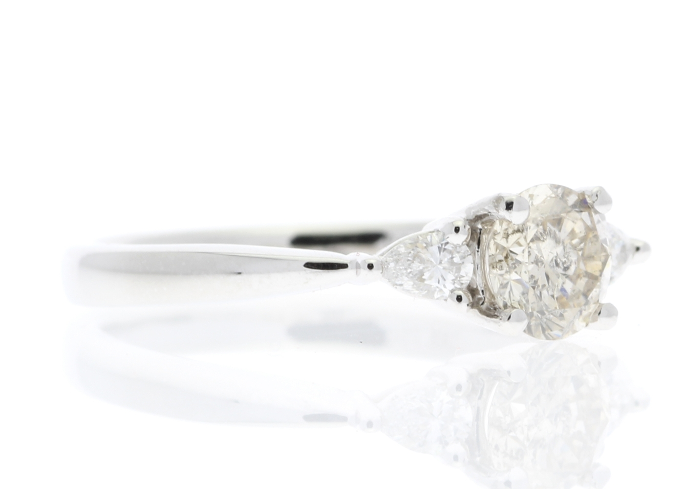 Lot 31 - 18ct White Gold Three Stone Claw Set Diamond Ring (0.59) 0.75 Carats