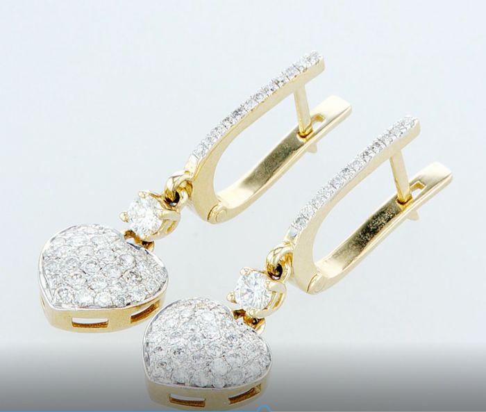 Lot 32 - 14 k. Yellow gold - Earrings Round Brilliant Diamond -0.97ctw