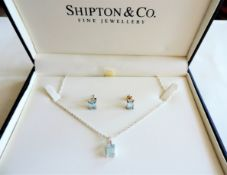 Sterling Silver Topaz Necklace and Earrings Set