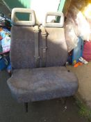 Double van seat and single drivers with belts