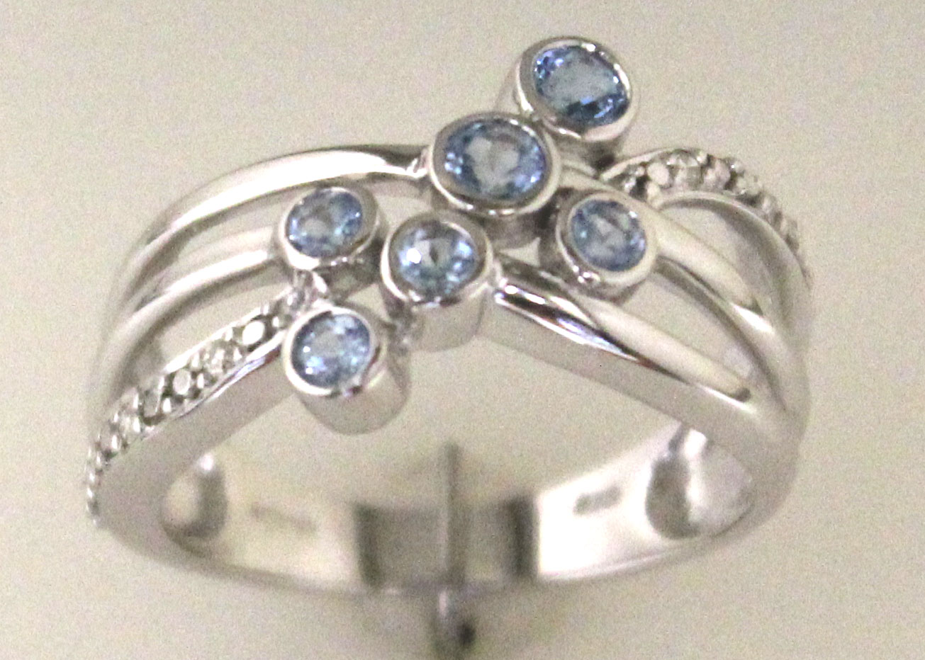 Lot 54 - 9ct White Gold Fancy Cluster Diamond And Blue Topaz Ring