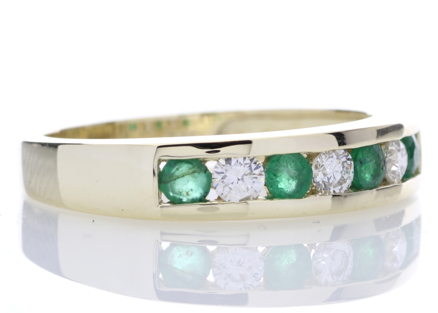 Lot 44 - 9ct Yellow Gold Channel Set Semi Eternity Diamond And Emerald Ring 0.25 Carats
