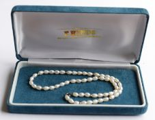 Set Of Pearls With Gold Coloured Beads And Clasp