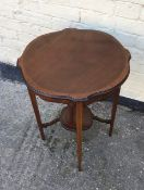 Antique mahogany inlaid occaisional table with raised under teir.