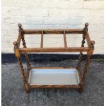 An antique oak stick stand.