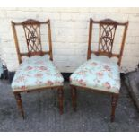 Antique pair of late Victorian walnut side chairs.