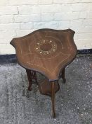 Antique inlaid mahogany Edwardian occaisional table with shaped top and fretwork supports.