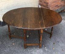 A 20 century oak gate leg table.