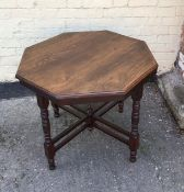 An antique mahogany octagonal centre table