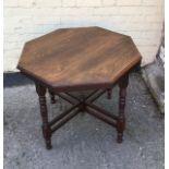 An antique mahogany octagonal centre table