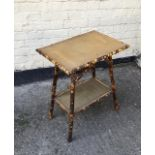 A vintage bamboo and rattan side table.