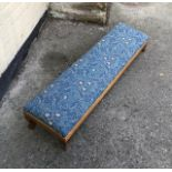 An antique double footstool.