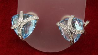 9ct 375 White Gold Diamond & Trillion Cut Topaz Stud Earrings