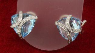 9ct 375 White Gold Diamond & Trillion Cut Topaz Stud Earrings