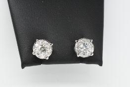 Pair of Round Diamond Earrings.