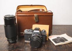 "Kamera ""Minolta XE-1"" (Bj. ab 1974/75 - 1977), Nr. 1078651, 1x Objektiv ""MC Rokkor-PG"" von"