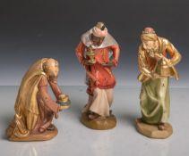 Konvolut von 3 Holzfiguren von den Heiligen Drei Königen, vollplastisch geschnitzt,