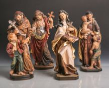 Konvolut von 4 versch. Holzfiguren von Heiligen, vollplastisch geschnitzt, polychrom