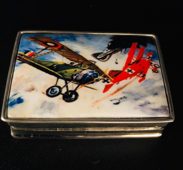 Lot 28 - A Silver Pill Box with enamel image of WWI Bi Planes Fighting