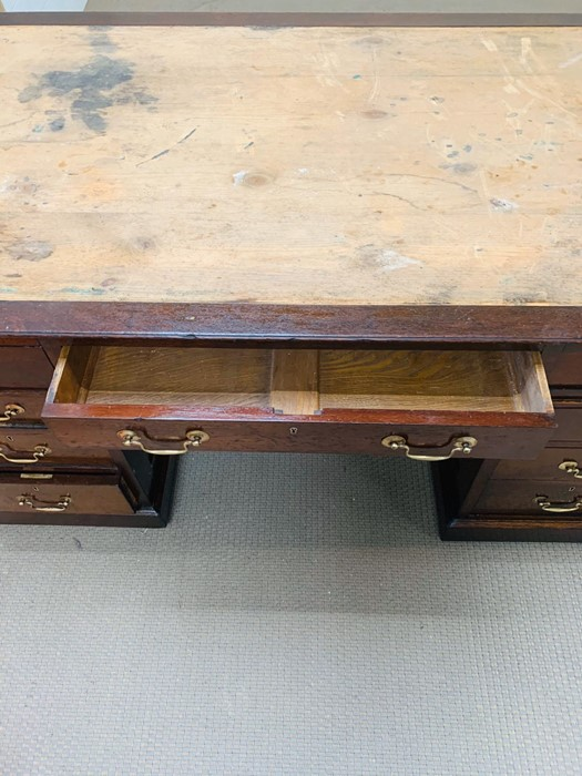 Lot 294 - A Mahogany Victorian Partners Desk 5' x 3', drawers and cupboards with brass swan neck handles and