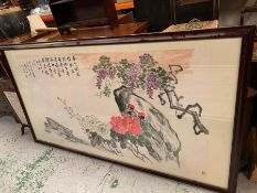 A large framed oriental print featuring cherry blossom, signed