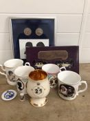A selection of Royal collectable items to include cups, cars and a print
