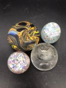 A selection of four paperweights
