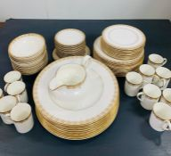 A Selection of Royal Doulton Gold Lace pattern dinner service to include: 12 bowls, 12 saucers, 12