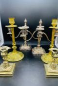 A selection of three pairs of candlesticks, brass and silver plated.