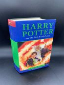 A First Edition Hard Back Harry Potter and the Half Blood Prince by J K Rowling with the misprint on