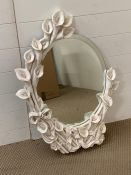 Oval mirror decorated with lilies to frame