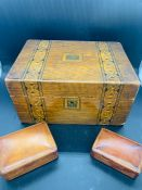 An inlaid work box and two leather jewellery boxes.