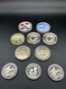 A Selection of Ten proof style coins with a military theme.