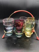 A selection of 50's/60's retro vintage Kitsch Harlequin coloured shot glasses set and wire stand