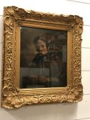 An Oil on Board of a Lady knitting in a gilt frame