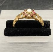 A 9 ct yellow gold seed pearl and garnet ring