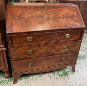 George III mahogany bureau, the slant front opening to an arrangement of drawers and pigeon holes (