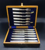 A Mother of Pearl Handled box set of six knives and forks