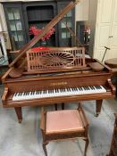 C Bechstein Grand Piano made in Germany with turned legs. It has eighty-eight note keyboard and