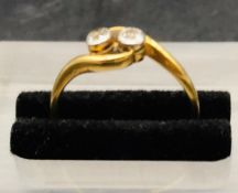 A Two Stone Diamond Ring in an 18 ct gold setting