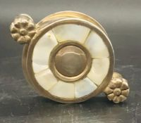 A Mother of Pearl and white metal magnifier.