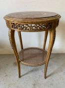 Oval marble topped gilt centre table with pierced frieze and cane shelf on cabriole legs (H78cm